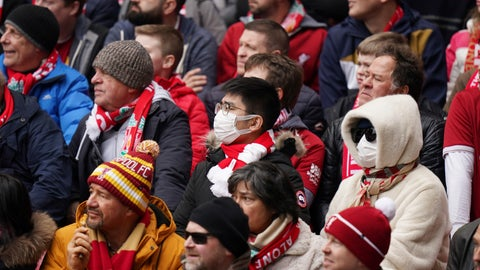 <p>               A fan wearing a protective mask attends at the English Premier League soccer match between Liverpool and Bournemouth at Anfield stadium in Liverpool, England, Saturday, March 7, 2020. (AP Photo/Jon Super)             </p>