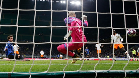 <p>               Atalanta's Hans Hateboer, right, scores his side's opening goal during the Champions League round of 16, first leg, soccer match between Atalanta and Valencia at the San Siro stadium in Milan, Italy, Wednesday, Feb. 19, 2020. (AP Photo/Antonio Calanni)             </p>