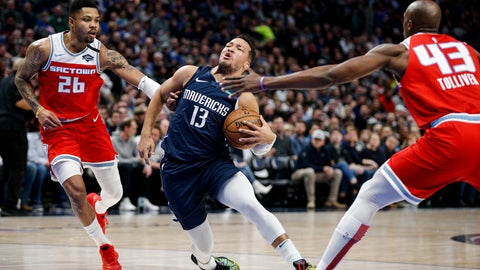 <p>               Dallas Mavericks guard Jalen Brunson (13) battles Sacramento Kings guard Kent Bazemore (26) and Anthony Tolliver (43) for space during the first half of an NBA basketball game, Wednesday, Feb. 12, 2020, in Dallas. (AP Photo/Brandon Wade)             </p>