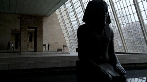 <p>               A few visitors walk around an Egyptian exhibit at the Metropolitan Museum of Art in New York, Tuesday, March 10, 2020. New York state is shuttering schools and houses of worship for two weeks in part of a suburb and sending the National Guard there to help respond to what appears to be the nation's biggest cluster of cases of the coronavirus.(AP Photo/Seth Wenig)             </p>