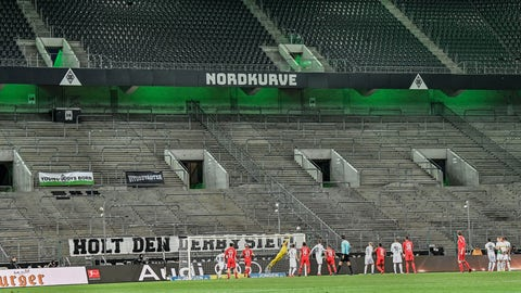<p>               Players challenge for the ball in an empty stadium during the German Bundesliga soccer match between Borussia Moenchengladbach and 1.FC Cologne in Moenchengladbach, Germany, Wednesday, March 11, 2020. It is the first Bundesliga match played behind closed doors without spectators due to the coronavirus outbreak. For most people, the new coronavirus causes only mild or moderate symptoms, such as fever and cough. For some, especially older adults and people with existing health problems, it can cause more severe illness, including pneumonia. (AP Photo/Martin Meissner)             </p>