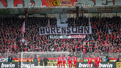 "<p>               Union fans on the tribune display a banner reading ""Son of a bitch"" against TSG Hoffenheim club patron Dietmar Hopp during the German Bundesliga soccer match between 1. FC Union Berlin and VfL Wolfsburg, in Berlin, Germany, Sunday, March 1, 2020. (Andreas Gora/dpa via AP)             </p>"