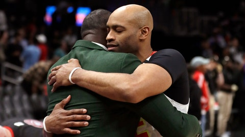 <p>               Atlanta Hawks guard Vince Carter, right, hugs former Hawk Dominique Wilkins as he leaves the court following an NBA basketball game against the New York Knicks Wednesday, March 11, 2020, in Atlanta. (AP Photo/John Bazemore)             </p>