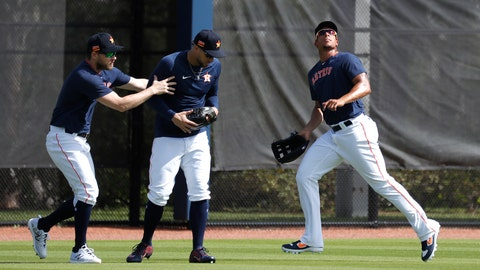 <p>               Houston Astros outfielders Josh Reddick and George Springer duck for cover as Michael Brantley runs after a fly ball during spring training baseball practice, Tuesday, Feb. 18, 2020 in West Palm Beach, Fla. (Karen Warren/Houston Chronicle via AP)             </p>