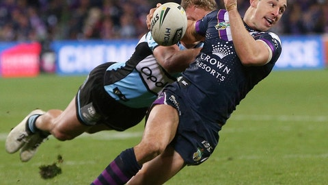 <p>               FILE - In this Sept. 21, 2018, photo provided by AAP, Melbourne Storm rugby league player Billy Slater, right, is tackled by Matt Moylan of the Sharks during the National Rugby League preliminary final match in Melbourne, Australia. The Aussie rules Australian Football League, the National Rugby League and soccer's A-League competitions are all going ahead despite heavy travel restrictions and bans on crowds of more than 500 assembling at outdoor venues amid the coronavirus pandemic. The only difference is that there are no fans there to watch. (Hamish Blair/AAP Image via AP, File)             </p>