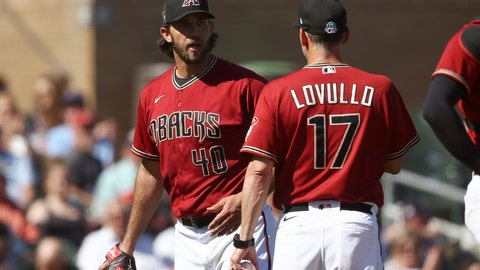 <p>               Arizona Diamondbacks starting pitcher Madison Bumgarner (40) talks with manager Torey Lovullo, right, after leaving a spring training baseball game after pitching a shutout into the fourth inning against the Kansas City Royals, Monday, March 9, 2020, in Scottsdale, Ariz. (AP Photo/Ross D. Franklin)             </p>