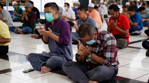 <p>               Malaysian Muslims prays during Friday prayers which was held with shorter sermons to prevent the spread of new coronavirus at the National Mosque in Kuala Lumpur, Malaysia, Friday, March 13, 2020. For most people, the new coronavirus causes only mild or moderate symptoms. For some it can cause more severe illness. (AP Photo/Vincent Thian)             </p>