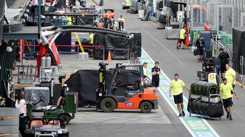 <p>               Workers pack up in pit lane after the cancellation of the Australian Formula One Grand Prix in Melbourne, Friday, March 13, 2020. The first F1 Grand Prix of the season was canceled two hours before the first official practice was set to start Friday after organizers relented to pressure to call it off amid the spreading coronavirus. (Michael Dodge/AAP Image via AP)             </p>