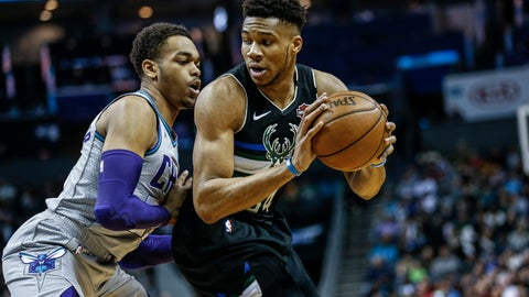 <p>               Milwaukee Bucks forward Giannis Antetokounmpo, right, looks to drive against Charlotte Hornets forward P.J. Washington in the first half of an NBA basketball game in Charlotte, N.C., Sunday, March 1, 2020. (AP Photo/Nell Redmond)             </p>