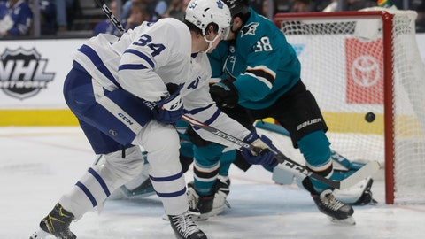 <p>               Toronto Maple Leafs center Auston Matthews, left, scores a goal against the San Jose Sharks during the second period of an NHL hockey game in San Jose, Calif., Tuesday, March 3, 2020. (AP Photo/Jeff Chiu)             </p>