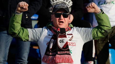 <p>               In this photo taken on Friday, March 27, 2020, a fan of Belshina Bobruisk team cheers during the Belarus Championship soccer match between Torpedo-BelAZ Zhodino and Belshina Bobruisk in the town of Zhodino, Belarus. Longtime Belarus President Alexander Lukashenko is proudly keeping soccer and hockey arenas open even though most sports around the world have shut down because of the coronavirus pandemic. The new coronavirus causes mild or moderate symptoms for most people, but for some, especially older adults and people with existing health problems, it can cause more severe illness or death. (AP Photo/Sergei Grits)             </p>