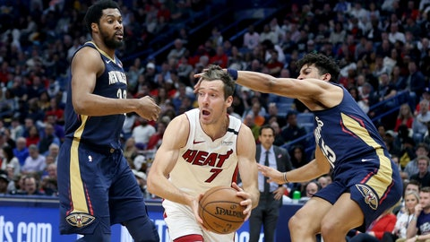 <p>               Miami Heat guard Goran Dragic (7) looks to pass the ball as New Orleans Pelicans center Derrick Favors (22) and guard Frank Jackson (15) defend during the first half of an NBA basketball game in New Orleans, Friday, March 6, 2020. (AP Photo/Rusty Costanza)             </p>