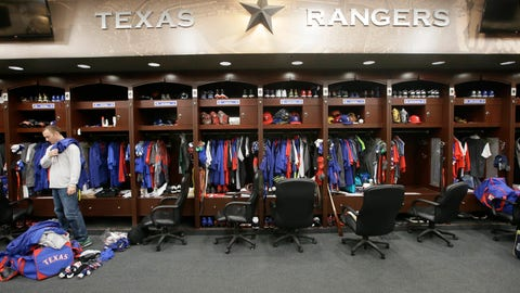 <p>               FILE - In this Oct. 11, 2016, file photo, Texas Rangers pitcher Sam Dyson, left, packs a bag in the locker room at the baseball park in Arlington, Texas. The NBA, NHL, Major League Baseball and Major League Soccer are closing access to locker rooms and clubhouses to all non-essential personnel in response to the coronavirus crisis, the leagues announced in a joint statement Monday, March 9, 2020. (AP Photo/LM Otero, File)             </p>