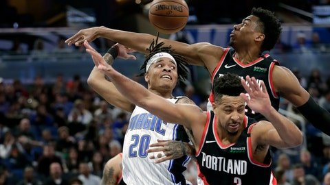 <p>               Orlando Magic guard Markelle Fultz (20) passes the ball behind his head as he gets trapped between Portland Trail Blazers center Hassan Whiteside, back right, and guard CJ McCollum (3) during the second half of an NBA basketball game, Monday, March 2, 2020, in Orlando, Fla. (AP Photo/John Raoux)             </p>
