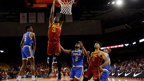 <p>               Southern California forward Onyeka Okongwu (21) dunks against UCLA during the second half of an NCAA college basketball game Saturday, March 7, 2020, in Los Angeles. (AP Photo/Marcio Jose Sanchez)             </p>
