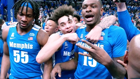 <p>               Memphis Tigers Precious Achiuwa (55), Lester Quinones (11) and Lance Thomas (15) celebrate after a win against Houston in an NCAA college basketball game Saturday, Feb. 22, 2020, in Memphis, Tenn. (AP Photo/Karen Pulfer Focht)             </p>