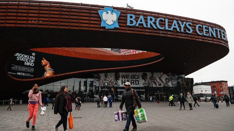 <p>               FILE - In this March 12, 2020, file photo, pedestrians walk past the Barclays Center, which is home to the Brooklyn Nets, in the Brooklyn borough of New York. The Nets announced on Tuesday, March 17, 2020, that four players have tested positive for the new coronavirus, bringing the total to seven known players in the NBA. (AP Photo/John Minchillo, File)             </p>