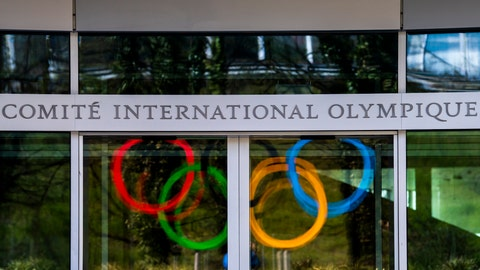 <p>               The Olympic Rings are displayed at the entrance of the IOC, International Olympic Committee headquarters during the coronavirus disease (COVID-19) outbreak in Lausanne, Switzerland, Tuesday, March 24, 2020. (Jean-Christophe Bott/Keystone via AP)             </p>