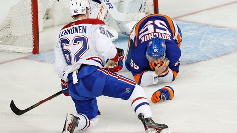 <p>               Montreal Canadiens left wing Artturi Lehkonen (62) watches as New York Islanders defenseman Johnny Boychuk (55) clutches his face after Lehkonen's skate hit him on the face during the third period of an NHL hockey game, Tuesday, March 3, 2020, in New York. The Canadiens won 6-2. (AP Photo/Kathy Willens)             </p>