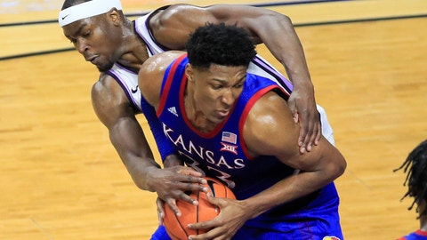 <p>               Kansas forward David McCormack (33) is fouled by Kansas State forward Makol Mawien, left, during the second half of an NCAA college basketball game in Manhattan, Kan., Saturday, Feb. 29, 2020. Kansas defeated Kansas State 62-58. (AP Photo/Orlin Wagner)             </p>