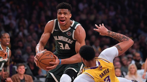 <p>               Milwaukee Bucks forward Giannis Antetokounmpo, knocks down Los Angeles Lakers forward Anthony Davis as he drives to the basket during the first half of an NBA basketball game Friday, March 6, 2020, in Los Angeles. (AP Photo/Mark J. Terrill)             </p>
