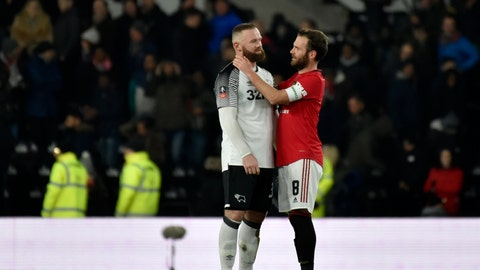 <p>               Derby's Wayne Rooney, left, speaks with Manchester United's Juan Mata at the end of the FA Cup fifth round soccer match between Derby County and Manchester United at Pride Park in Derby, England, Thursday, March 5, 2020. (AP Photo/Rui Vieira)             </p>