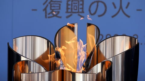 "<p>               The Olympic Flame burns during the Olympic ""Flame of Recovery"" display ceremony in Iwaki, northern Japan Wednesday, March 25, 2020. IOC President Thomas Bach has agreed ""100%"" to a proposal of postponing the Tokyo Olympics for about one year until 2021 because of the coronavirus outbreak, Japanese Prime Minister Shinzo Abe said Tuesday. (AP Photo/Eugene Hoshiko)             </p>"