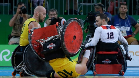 <p>               FILE - In this Sept. 18, 2016, file photo, Australia's Chris Bond falls watched by his teammate Ryley Batt, left, and United States' Chad Cohn during a mixed wheelchair rugby final match at the Paralympic Games in Rio de Janeiro, Brazil. A Tokyo Olympic test event featuring wheelchair rugby has been called off because of the threat of the spreading virus. The event was to take place on March 12-15, 2020 and original plans called for athletes from abroad. (AP Photo/Leo Correa, File)             </p>