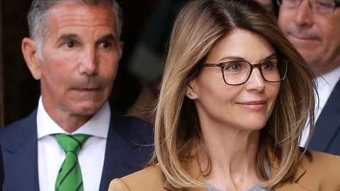 <p>               FILE - In this April 3, 2019, file photo, actress Lori Loughlin, front, and her husband, clothing designer Mossimo Giannulli, left, depart federal court in Boston. Eight parents, including Loughlin and Giannulli, are scheduled to go on trial in October 2020 for their involvement in a college admissions cheating scheme. (AP Photo/Steven Senne, File)             </p>