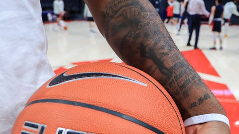 """<p>               In this Feb. 22, 2020, photo,  Dayton's Trey Landers stands on the court prior to the team's NCAA college basketball game against Duquesne in Dayton, Ohio. The tattoo on his arm says """"Dad I know you are always walking beside me"""" in honor of his father, who was fatally shot when Landers was 8 years old. (AP Photo/Aaron Doster)             </p>"""