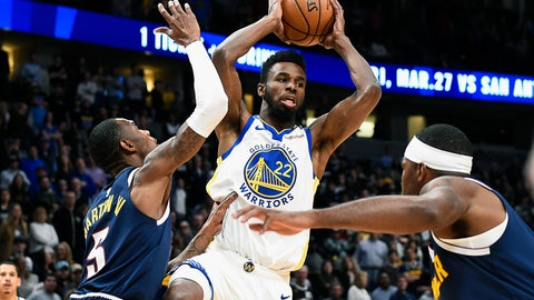 <p>               Golden State Warriors Andrew Wiggins (22) looks to make a pass as Denver Nuggets Will Baton lll (5) defends during the first half of an NBA basketball game Tuesday, March 3, 2020 in Denver (AP Photo/John Leyba)             </p>