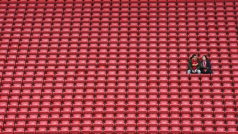 <p>               People sit surrounded by empty seats as they wait for the start of the English Premier League soccer match between Liverpool and Bournemouth at Anfield stadium in Liverpool, England, Saturday, March 7, 2020. (AP Photo/Jon Super)             </p>