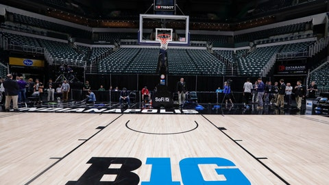<p>               The seating area at Bankers Life Fieldhouse is empty as media and staff mill about, Thursday, March 12, 2020, in Indianapolis, after the Big Ten Conference announced that remainder of the men's NCAA college basketball games tournament was cancelled. (AP Photo/Michael Conroy)             </p>