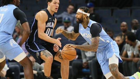 <p>               Minnesota Timberwolves' James Johnson, right, drives past Orlando Magic's Aaron Gordon in the first half of an NBA basketball game, Friday, March 6, 2020 in Minneapolis. (AP Photo/Jim Mone)             </p>