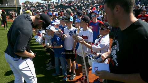 <p>               Cleveland Indians' Mike Freeman, left, signs autographs for fans as a Goodyear Stadium employee holds a container of pens and autograph cards prior to the team's spring training baseball game against the Chicago Cubs on Saturday, March 7, 2020, in Goodyear, Ariz. The stadium offered the items for players to sign autographs as a precaution for the coronavirus. (AP Photo/Ross D. Franklin)             </p>