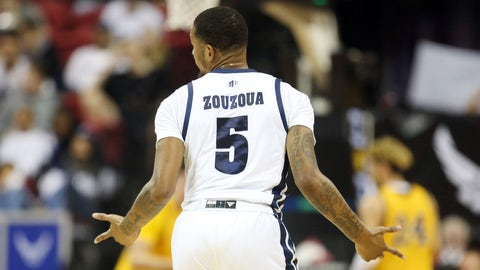 <p>               Nevada's Nisre Zouzoua reacts after sinking a 3-point shot during the first half of the team's Mountain West Conference tournament NCAA college basketball game against Wyoming on Thursday, March 5, 2020, in Las Vegas. (AP Photo/Isaac Brekken)             </p>