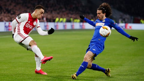 <p>               Ajax's Sergino Dest, left, and Getafe's Marc Cucurella vie for the ball during a round of 32, second leg, Europa League soccer match between Ajax and Getafe at the Johan Cruyff ArenA in Amsterdam, Netherlands, Thursday, Feb. 27, 2020. (AP Photo/Peter Dejong)             </p>