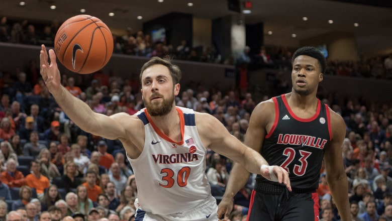 Clark hits 3 to lift No. 22 Virginia past No. 10 Louisville