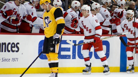 <p>               Pittsburgh Penguins' Brian Dumoulin, left, skates to the bench as Carolina Hurricanes' Jake Gardiner (51) is greeted by teammates after giving his team the lead with a goal during the second period of an NHL hockey game, Sunday, March 8, 2020, in Pittsburgh. (AP Photo/Keith Srakocic)             </p>
