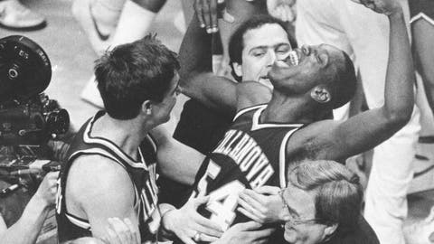 <p>               FILE - In this April 1, 1985, file photo, Villanova's Ed Pinckney (54) yells out as he is surrounded by teammates after defeating Georgetown 66-64 in the NCAA college basketball Final Four championship game, in Lexington, Ky. (AP Photo/Gary Landers, File)             </p>