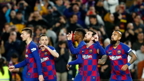 <p>               Barcelona's Lionel Messi, second right, celebrates after scoring his side's opening goal from the penalty spot during a Spanish La Liga soccer match between Barcelona and Real Sociedad at the Camp Nou stadium in Barcelona, Spain, Saturday, March 7, 2020. (AP Photo/Joan Monfort)             </p>