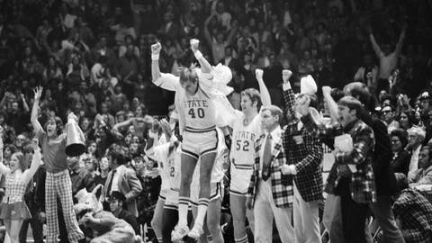 <p>               FILE - In this March 23, 1974, file photo, North Carolina State's Mark Noeller (40) jumps into the air as they defeat UCLA 80-77 in double overtime in a semifinal game at the NCAA college basketball championships in Greensboro, N.C. (AP Photo/File)             </p>