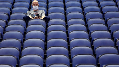 <p>               Mike Lemcke, from Richmond, Va., sits in an empty Greensboro Coliseum after the NCAA college basketball games were canceled at the Atlantic Coast Conference tournament in Greensboro, N.C., Thursday, March 12, 2020. (AP Photo/Ben McKeown)             </p>
