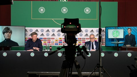"""<p>               In this photo provided by DFB, from left, Germany soccer coach Joachim Low appearing via video link, German soccer federation spokesman Jens Gritter, President of the DFB Fritz Keller and team manager Oliver Bierhoff take part in an online press conference without any journalists because of fears over the new coronavirus, Wednesday, March 18, 2020. Low thinks the coronavirus pandemic is a sign that Earth is """"defending itself a bit"""" against modern society, and said the widespread outbreak should be a wake-up call for people focused only on """"power, greed, profit.""""For most people, the new coronavirus causes only mild or moderate symptoms. For some it can cause more severe illness. (Thomas Bocker/DFB via AP)             </p>"""
