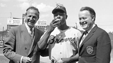 <p>               FILE - In this May 17, 1970, file photo, Atlanta Braves' Hank Aaron, center, who became the ninth player in Major League history to get 3,000 hits, kisses a baseball alongside Famer Stan Musial and Braves owner Bill Bartholomay, in Cincinnati. Bartholomay, the former Braves owner who moved the team from Milwaukee to Atlanta in 1966, died Wednesday, March 25, 2020, at New York-Presbyterian Hospital, according to his daughter, Jamie. He was 91. Bartholomay sold the Braves to Ted Turner in 1976 but remained as chairman of the team's board of directors until 2003, when he assumed an emeritus role. (AP Photo/Gene Smith, File)             </p>