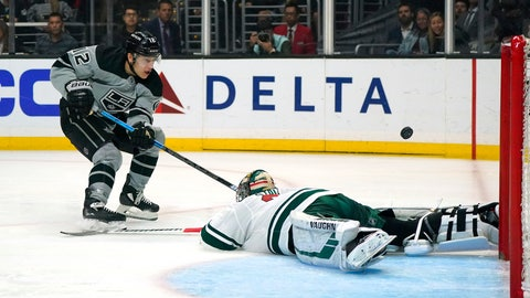 <p>               Los Angeles Kings center Trevor Moore, left, scores on Minnesota Wild goaltender Alex Stalock during the second period of an NHL hockey game Saturday, March 7, 2020, in Los Angeles. (AP Photo/Mark J. Terrill)             </p>