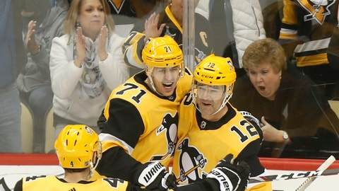 <p>               Fans celebrate behind Pittsburgh Penguins' Evgeni Malkin (71) and Justin Schultz (4) as they greet Patrick Marleau (12) who scored against the Carolina Hurricanes during the first period of an NHL hockey game, Sunday, March 8, 2020, in Pittsburgh. (AP Photo/Keith Srakocic)             </p>
