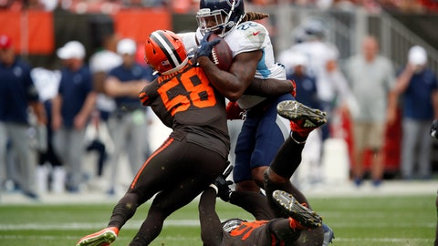 <p>               FILE - In this Sept. 8, 2019, file photo, Tennessee Titans running back Derrick Henry (22) is stopped by then-Cleveland Browns outside linebacker Christian Kirksey (58) during an NFL football game in Cleveland. Linebacker Christian Kirksey has agreed to terms on a deal with the Green Bay Packers less than a week after the Cleveland Browns released him. Kirksey's agent, Brian Mackler, confirmed that Kirksey would be signing with the Packers but didn't disclose terms.(AP Photo/Jeff Haynes, File)             </p>