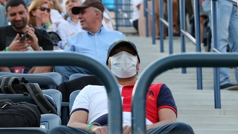 <p>               FILE - In this Friday, Feb. 28, 2020, file photo, a tennis fan wearing a facemask waits for the start of the semifinal matches of the Dubai Duty Free Tennis Championship in Dubai, United Arab Emirates. The ATP called off all men's professional tennis tournaments for six weeks because of the COVID-19 pandemic, but a WTA spokeswoman told The Associated Press on Thursday, March 12, 2020, that the women's tour was not immediately prepared to do the same.  (AP Photo/Kamran Jebreili, File)             </p>
