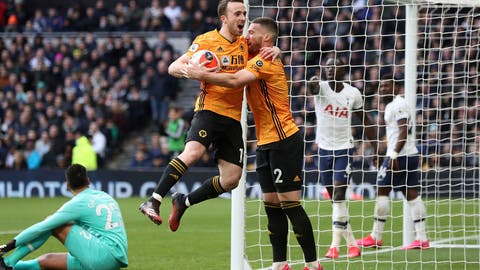 <p>               Wolverhampton Wanderers' Diogo Jota, center left, celebrates scoring his side's second goal of the game with teammate Matt Doherty during the English Premier League soccer match between Tottenham and Wolverhampton Wanderers at the Tottenham Hotspur Stadium, London, Sunday, March 1, 2020. (Bradley Collyer/PA via AP)             </p>